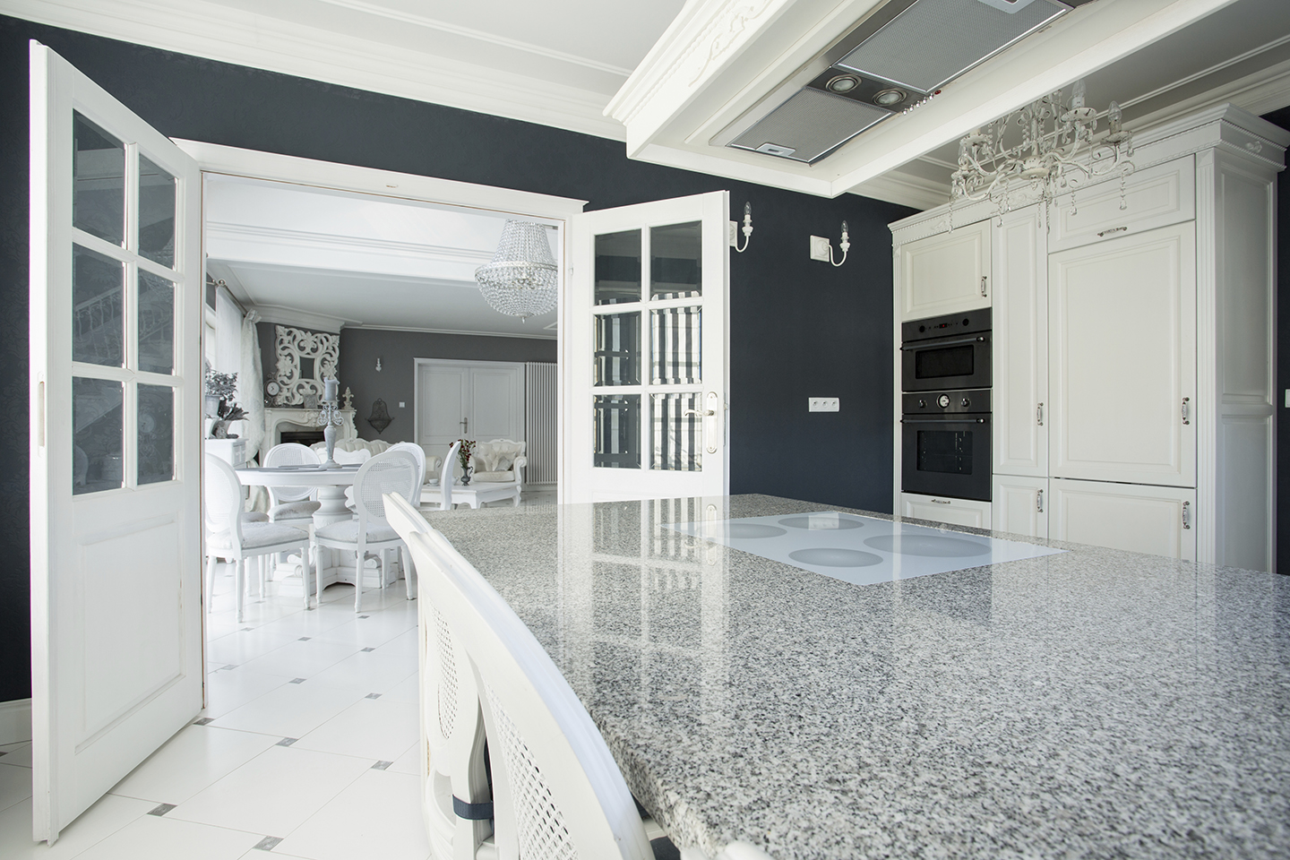 View of expensive kitchen with marble worktop