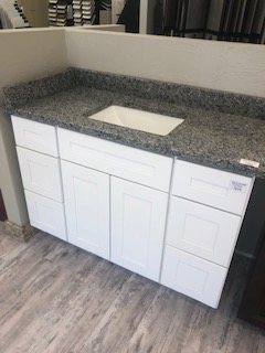 White Shaker vanity with Oyster Pearl granite