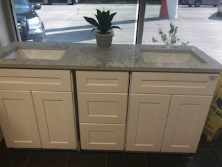 White shaker vanity cabinets with Montblanc quartz